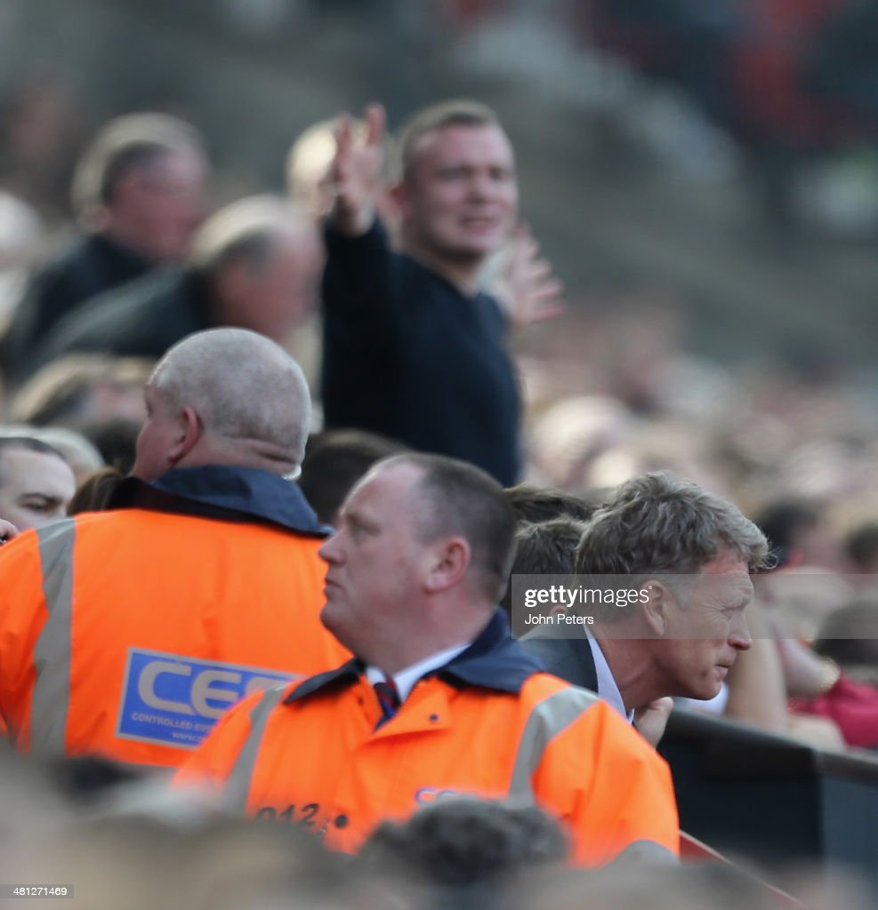 Manager David Moyes of Manchester United reacts to Ashley Westwood of Aston Villa scoring their first goal during the Barclays Premier League match between Manchester United and Aston Villa at Old Trafford on March 29, 2014 in Manchester, England.