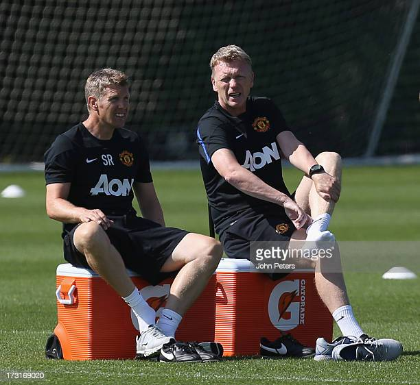 Manager David Moyes of Manchester United talks to assistant manager Steve Round during a first team training session at the Aon Training Complex on...