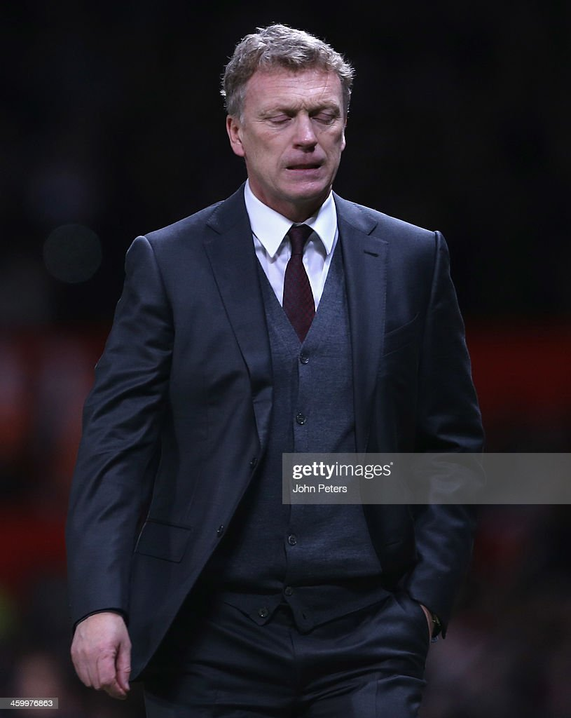 Manager David Moyes of Manchester United walks off after the Barclays Premier League match between Manchester United and Tottenham Hotspur at Old Trafford on January 1, 2014 in Manchester, England.