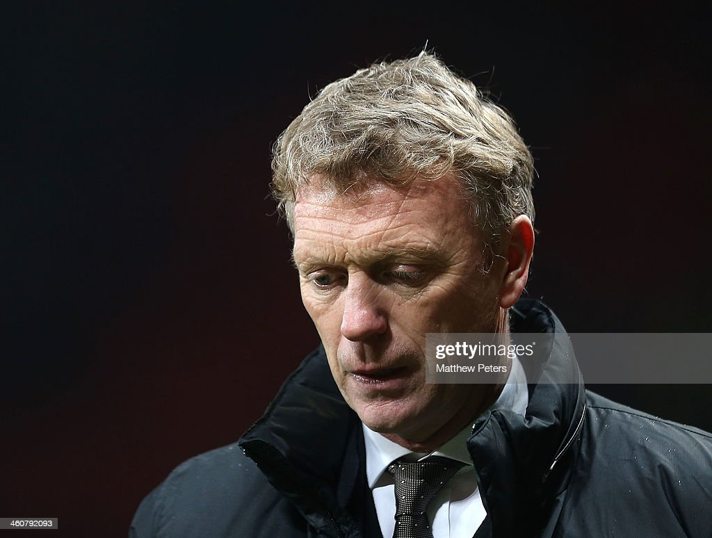 Manager David Moyes of Manchester United walks off after the FA Cup Third Round match between Manchester United and Swansea City at Old Trafford on January 5, 2014 in Manchester, England.