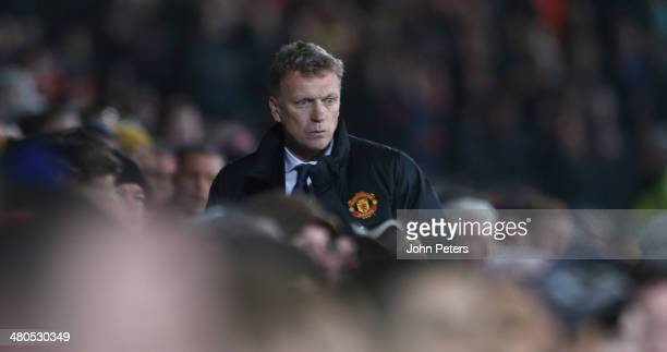 Manager David Moyes of Manchester United watches from the dugout during the Barclays Premier League match between Manchester United and Manchester...