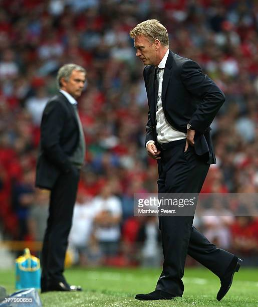 Manager David Moyes of Manchester United watches from the touchline during the Barclays Premier League match between Manchester United and Chelsea at...