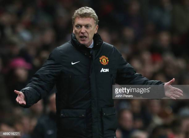 Manager David Moyes of Manchester United watches from the touchline during the Barclays Premier League match between Arsenal and Manchester United at...