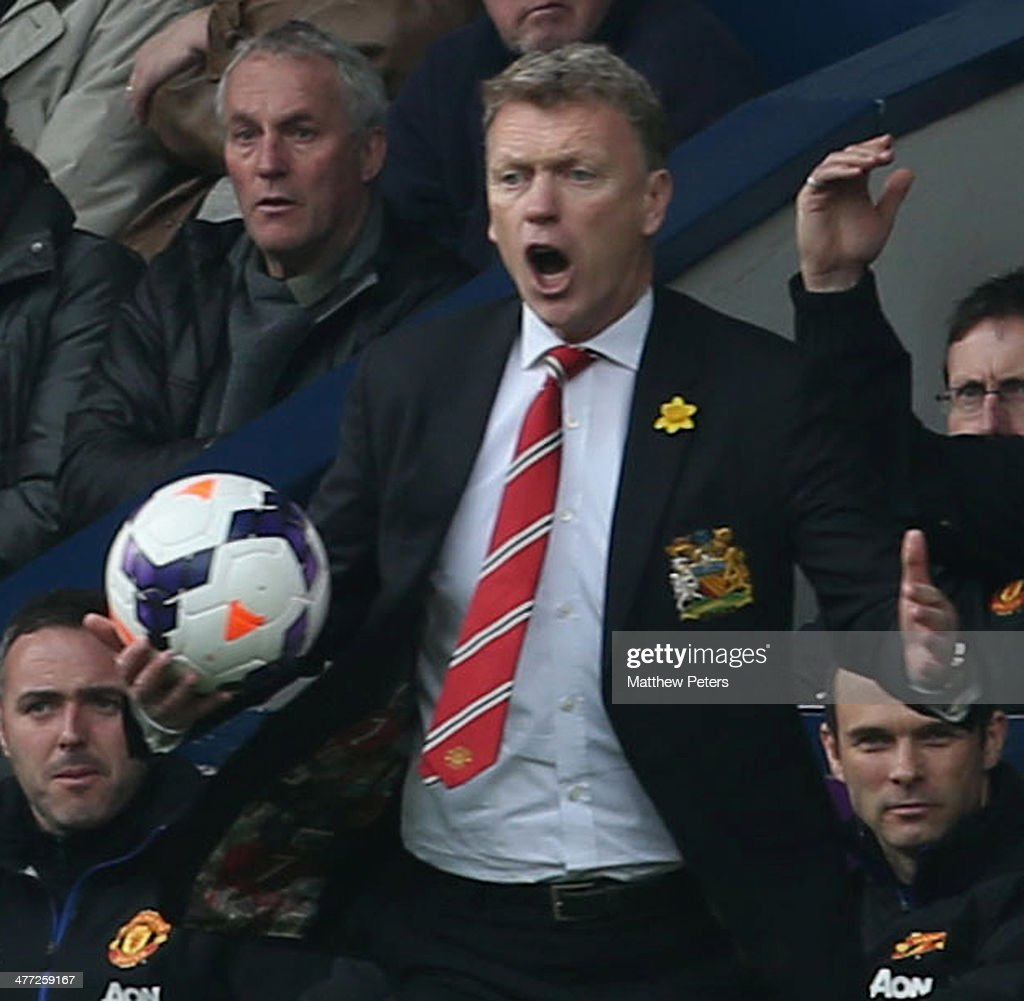 Manager David Moyes of Manchester United watches from the touchline during the Barclays Premier League match between West Bromwich Albion and Manchester United at The Hawthorns on March 8, 2014 in West Bromwich, England.