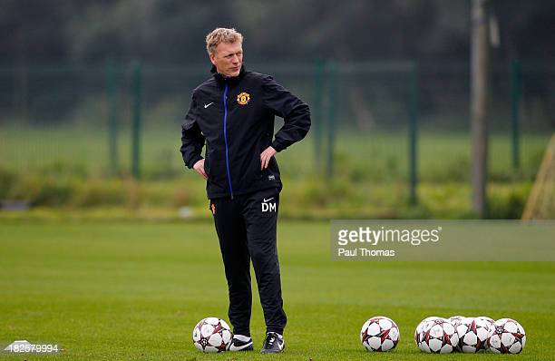 Manager David Moyes of Manchester United watches his players during a training session ahead of their Champions League Group A match against Shakhtar...