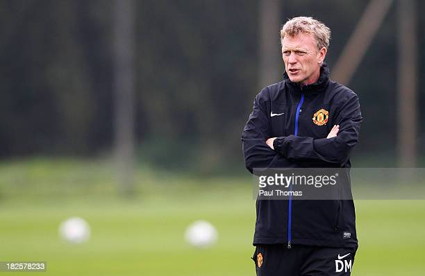 Manager David Moyes of Manchester United watches on during a training session ahead of their Champions League Group A match against Shakhtar Donetsk...