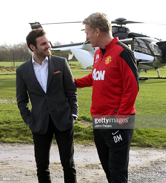 Manager David Moyes of Manchester United welcomes Juan Mata ahead of his medical at Aon Training Complex on January 25, 2014 in Manchester, England.