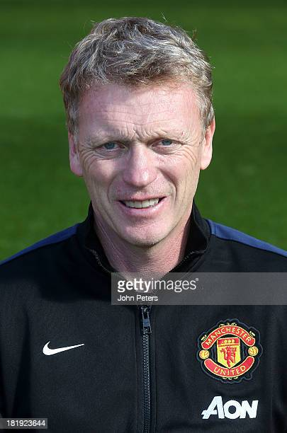 Manager David Moyes of Manchester Unted poses at the annual club photocall at Old Trafford on September 26 2013 in Manchester England