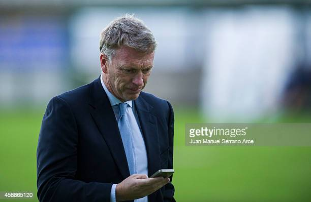 Manager David Moyes of Real Sociedad talking on mobile phone during the training session at the Zubieta training ground in San Sebastian on November...