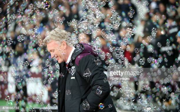 Manager David Moyes of West Ham United walks through the bubbles at London Stadium ahead of the Premier League match between West Ham United and...
