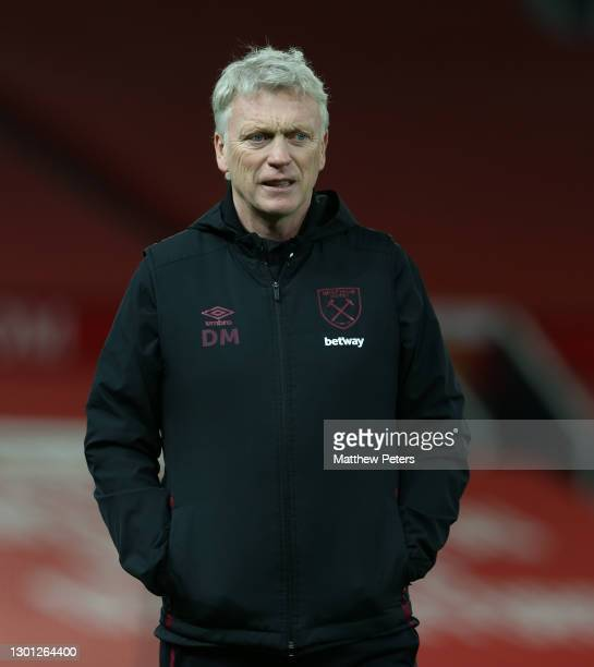 Manager David Moyes of West Ham United watches the warm up during The Emirates FA Cup Fifth Round match between Manchester United and West Ham United...