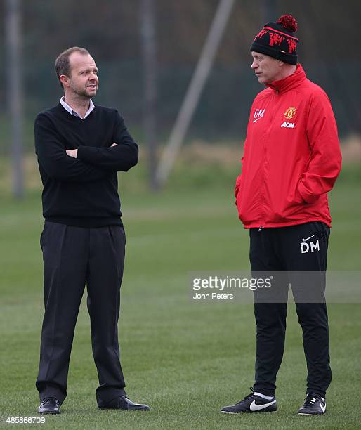 Manager David Moyes talks to Executive Vice Chairman Ed Woodward of Manchester United during a first team training session at Aon Training Complex on...