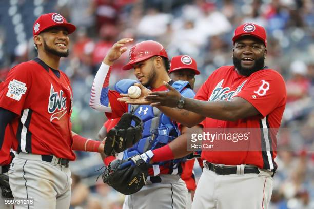 Manager David Ortiz of the World Team gestures with a baseball during a pitching change against the U.S. Team in the SiriusXM All-Star Futures Game...