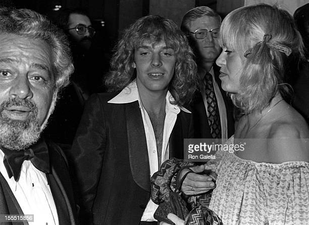 Manager Dee Anthony musician Peter Frampton and Penny McCall attend the party honoring Clive Davis on February 24 1978 at the Beverly Wilshire Hotel...