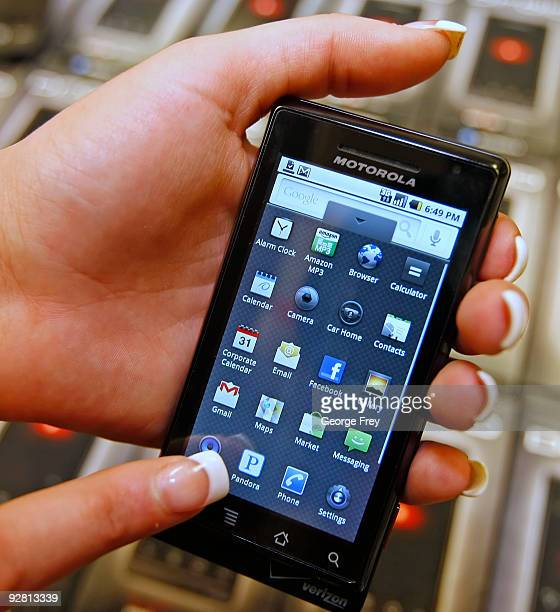 A manager demonstrates Motorola's new Droid smart phone sold through Verizon at the Verizon store November 5 2009 in Orem Utah The Google powered...