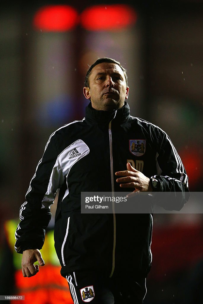 Manager Derek McInnes of Bristol City applauds the fans as he leaves the pitch at the end of the 4-0 defeat to Leicester City during the npower Championship match between Bristol City and Leicester City at Ashton Gate on January 12, 2013 in Bristol, England.