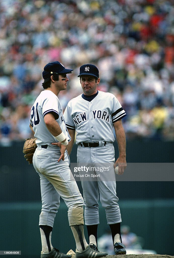 Manager Dick Howser #10 of the New York Yankees stands on the mound talking with shortstop Bucky Dent #20 during an Major League Baseball game circa 1980. Howser managed the Yankees in 1978 and 1980.
