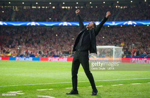 Manager Diego Simeone of Club Atletico de Madrid celebrates after his team scored their opening goal during the UEFA Champions League group C match...