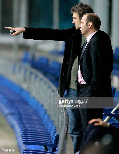 Manager Dietmar Beiersdorfer and President Bernd Hoffmann watch the players during the training session of Hamburger SV on November 29, 2006 in...