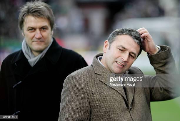 Manager Dietmar Beiersdorfer of Hamburg and Manager Klaus Allofs of Werder looks on before the Bundesliga match between Werder Bremen and Hamburger...
