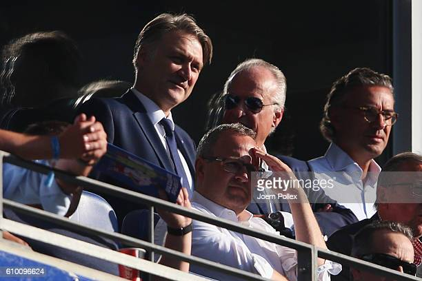 Manager Dietmar Beiersdorfer of Hamburg is seen on the tribune during the Bundesliga match between Hamburger SV and Bayern Muenchen at...