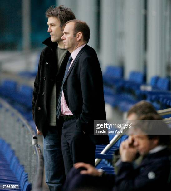 Manager Dietmar Beiersdorfer, President Bernd Hoffmann and Coach Thomas Doll watch the players during the training session of Hamburger SV on...