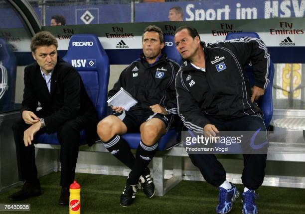 Manager Dietmar Beiersdorfer, second Coach Markus Schupp and Coach Huub Stevens of Hamburg looks on during the UEFA Cup second qualifying round...
