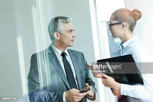Manager discussing with assistant
