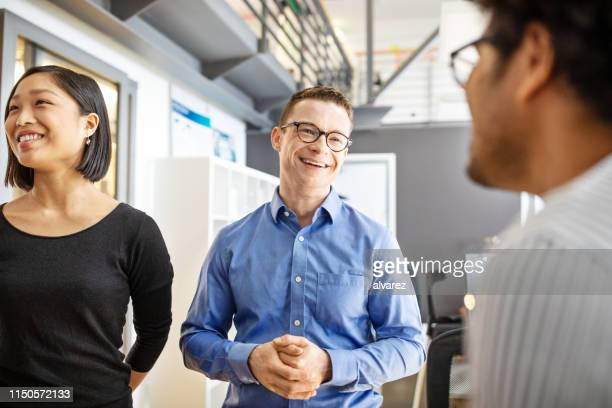 manager discussing with his team in office - three people stock pictures, royalty-free photos & images