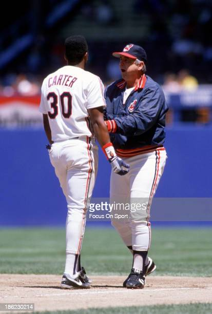 Manager Doc Edwards of the Cleveland Indians tries to calm down his player Joe Carter during an Major League Baseball game circa 1989 at Cleveland...