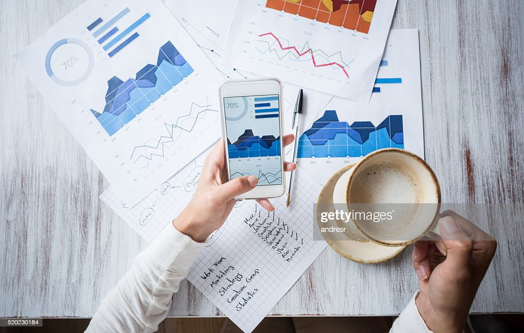 Manager doing the books at a restaurant : Stock Photo