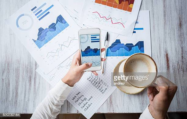 manager doing the books at a restaurant - finanza foto e immagini stock