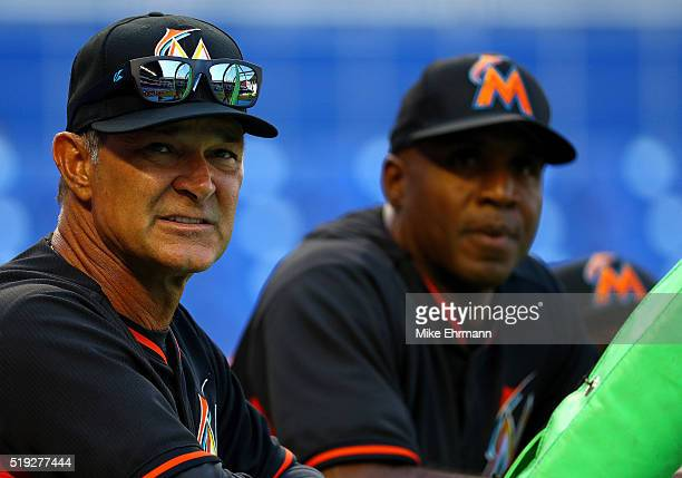 Manager Don Mattingly and hitting coach Barry Bonds of the Miami Marlins talk during 2016 Opening Day against the Detroit Tigers at Marlins Park on...