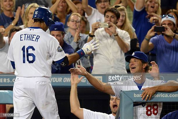 Manager Don Mattingly and Jamey Wright of the Los Angeles Dodgers celebrate the homerun of Andre Ethier to tie the game 33 against the San Diego...
