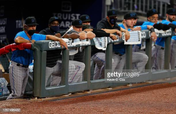 Manager Don Mattingly and the Miami Marlins stand in the dugout during the seventh inning of an exhibition game against the Atlanta Braves at Truist...