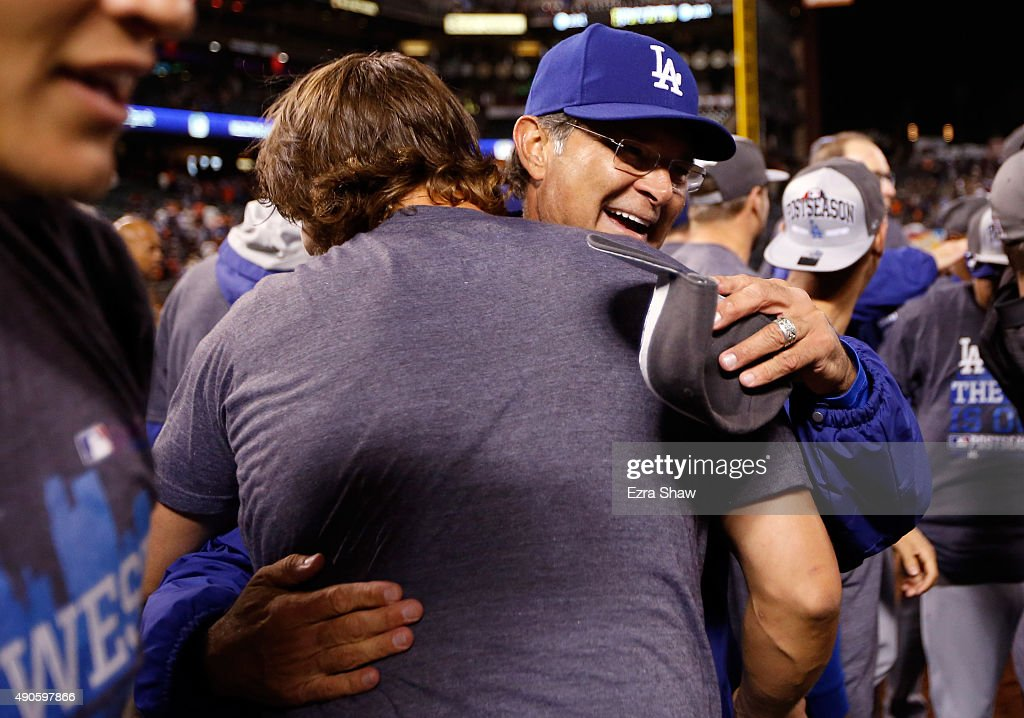 Manager Don Mattingly hugs Clayton Kershaw #22 of the Los Angeles Dodgers after they beat the San Francisco Giants to clinch the National League West title at AT&T Park on September 29, 2015 in San Francisco, California.