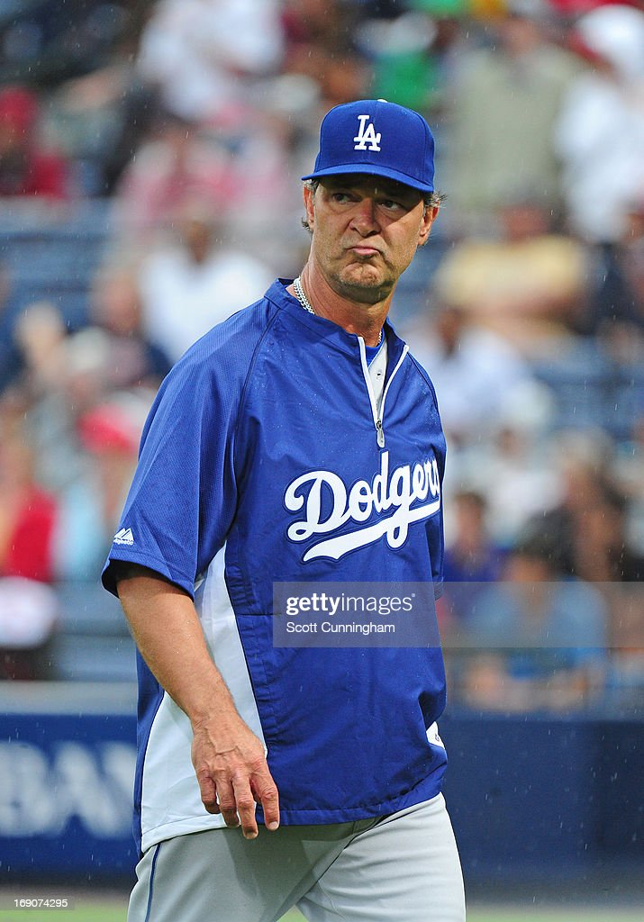 Manager Don Mattingly #8 of the Los Angeles Dodgers heads back to the dugout after making a pitching change against the Atlanta Braves at Turner Field on May 19, 2013 in Atlanta, Georgia.