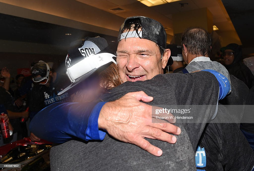 Manager Don Mattingly #8 of the Los Angeles Dodgers hugs one of his players after they defeated the San Francisco Giants 8-0 to clinch the National League West at AT&T Park on September 29, 2015 in San Francisco, California.