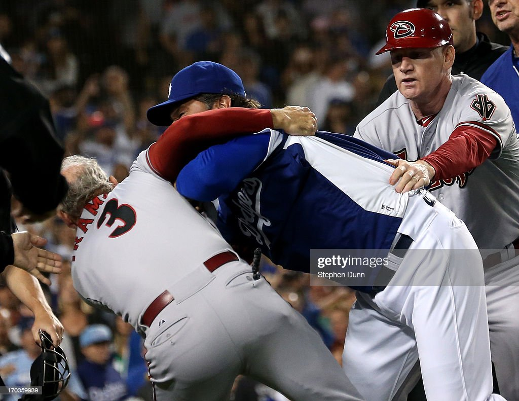 Manager Don Mattingly of the Los Angeles Dodgers pushes down coach Alan Trammell #3 of the Arizona Diamondbacks during as Diamondbacks coach Matt Williams tries to restrain Mattingly a bench clearing brawl in the seventh inning at Dodger Stadium on June 11, 2013 in Los Angeles,
