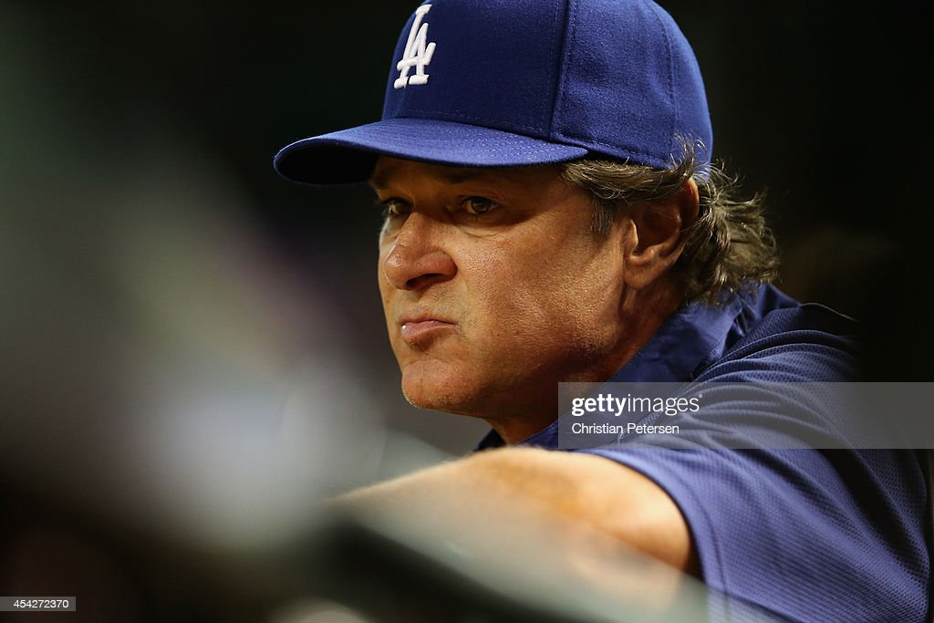 Manager Don Mattingly #8 of the Los Angeles Dodgers watches from the dugout during the MLB game against the Arizona Diamondbacks at Chase Field on August 27, 2014 in Phoenix, Arizona.