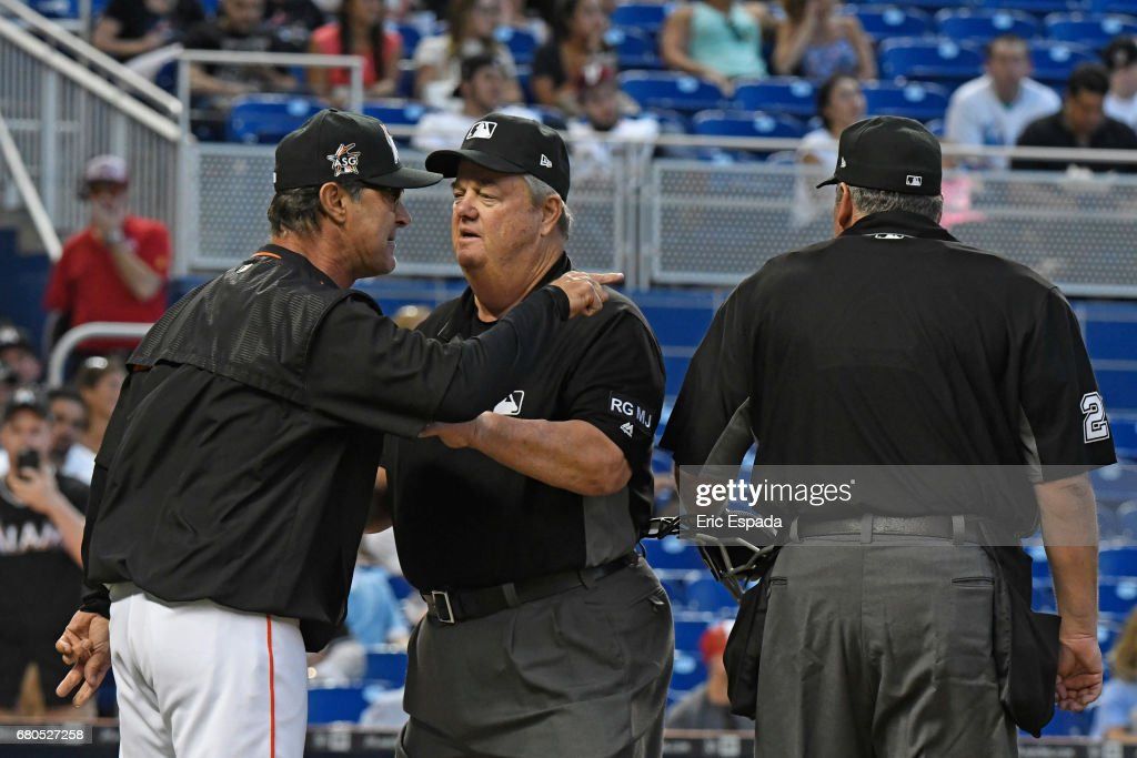 Manager Don Mattingly #8 of the Miami Marlins is held back by Third Base Umpire Joe West while arguing with Home Plate Umpire Hunter Wendelstedt during the second inning St. Louis Cardinals at Marlins Park on May 8, 2017 in Miami, Florida.
