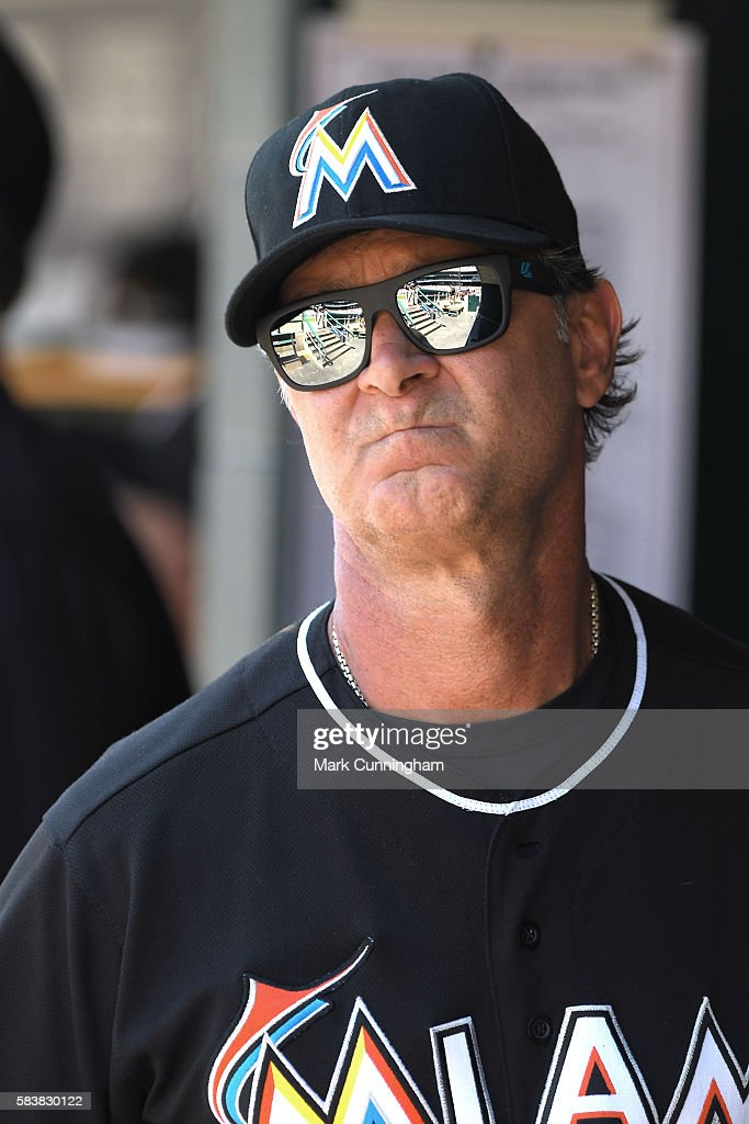Manager Don Mattingly #8 of the Miami Marlins looks on from the dugout while wearing a pair of Kaenon sunglasses during the game against the Detroit Tigers at Comerica Park on June 29, 2016 in Detroit, Michigan. The Tigers defeated the Marlins 10-3.