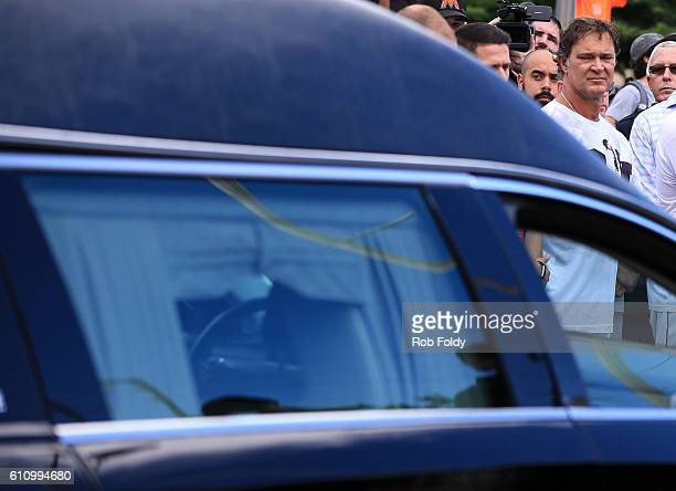 Manager Don Mattingly watches the hearse carrying Miami Marlins pitcher Jose Fernandez on September 28 2016 in Miami Florida Mr Fernandez was killed...