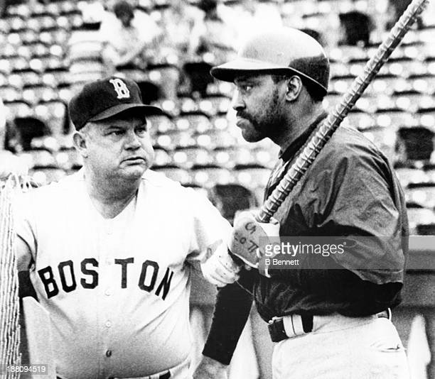 Manager Don Zimmer speaks with George Scott of the Boston Red Sox during batting practice before the game against the Texas Rangers on May 30 1979 at...