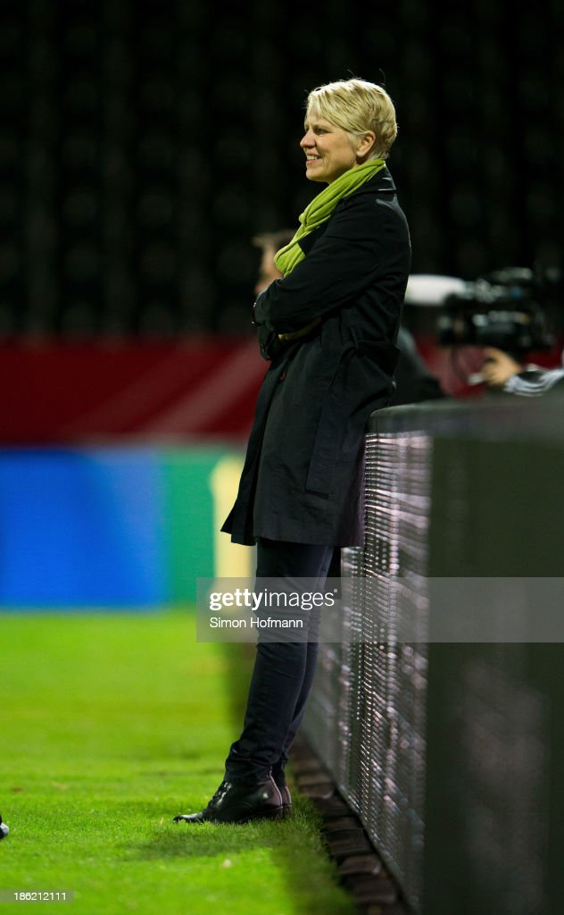 Manager Doris Fitschen of Germany smiles during a Germany training session at Volksbank Stadion on October 29, 2013 in Frankfurt am Main, Germany.