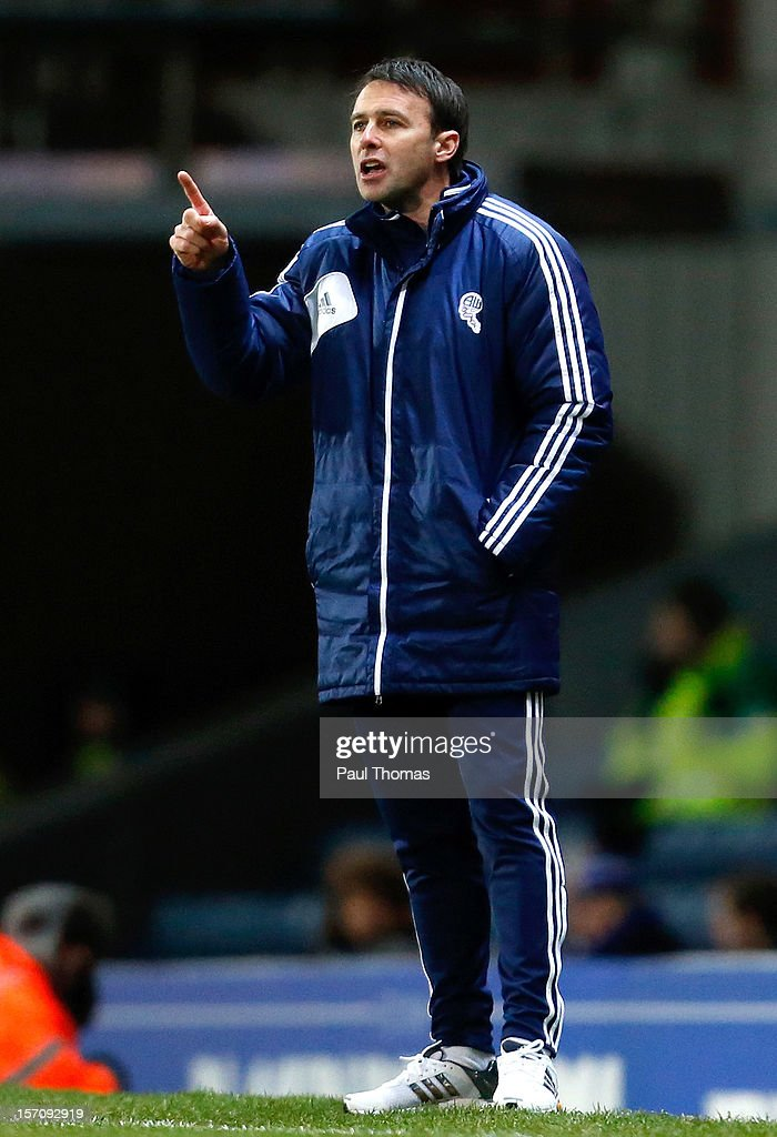 Manager Dougie Freedman of Bolton gestures during the npower Championship match between Blackburn Rovers and Bolton Wanderers at Ewood Park on November 28, 2012 in Blackburn, England.