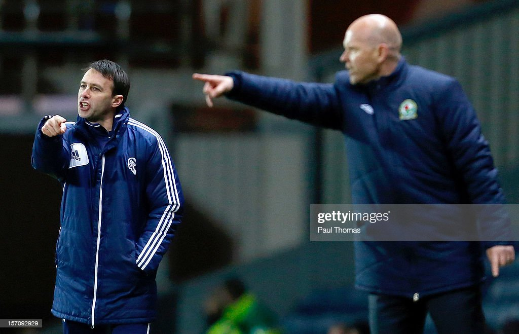 Manager Dougie Freedman (L) of Bolton gestures during the npower Championship match between Blackburn Rovers and Bolton Wanderers at Ewood Park on November 28, 2012 in Blackburn, England.