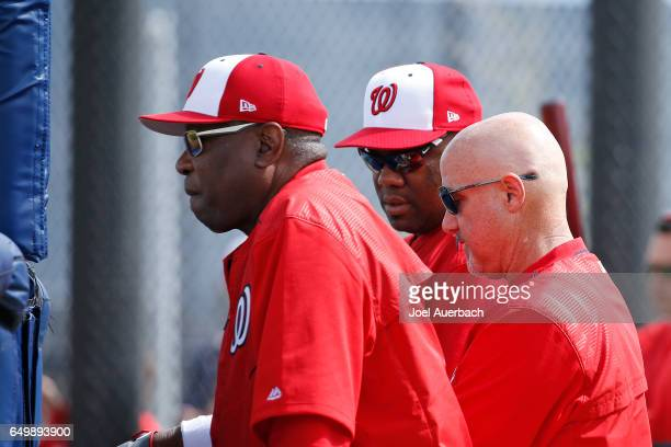 Manager Dusty Baker General Manager Mike Rizzo and former pitcher Livan Hernandez watch Max Scherzer of the Washington Nationals throw the ball prior...