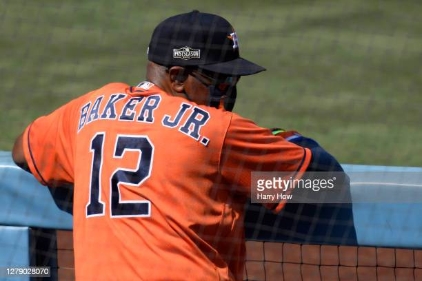 Manager Dusty Baker Jr. #12 of the Houston Astros looks on against the Oakland Athletics during the first inning in Game Three of the American League...