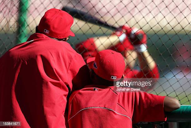 Manager Dusty Baker of the Cincinnati Reds and his son Darren look on during batting practice before taking on the San Francisco Giants in Game Three...